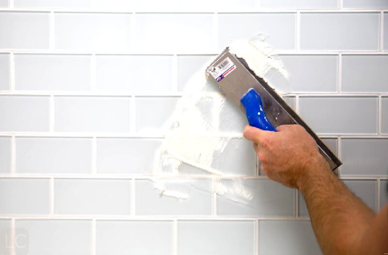 Apply grout evenly - Guide to regrouting tiles regrout bathroom tiles