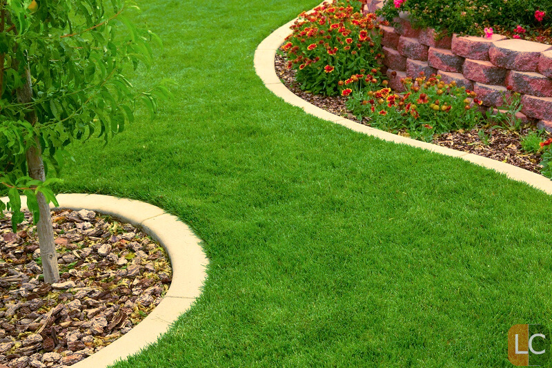 laying fake grass -a beautiful lawn